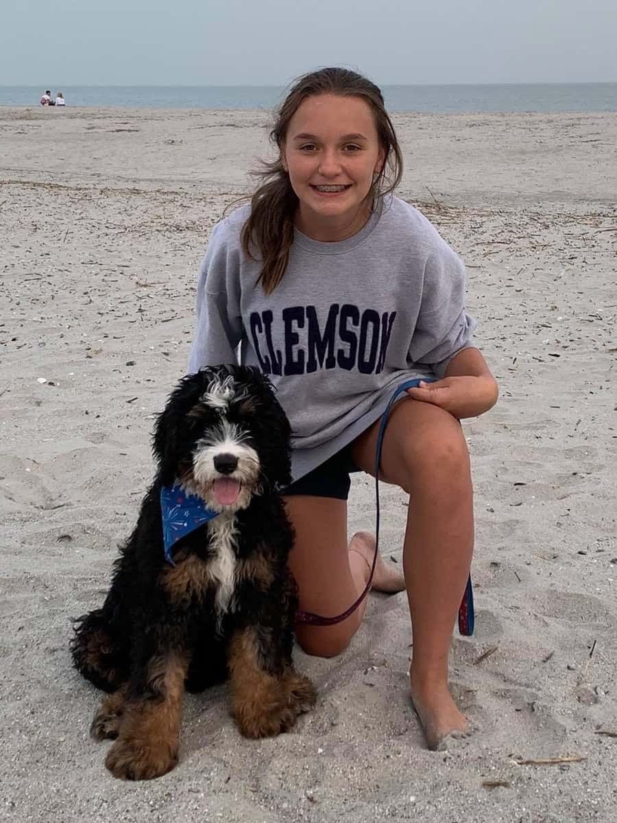 Girl with Dog at Beach